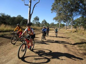 bike rider group on quiet gravel country road